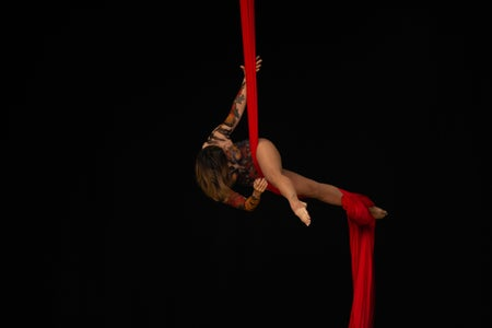 Woman practicing aerial silk