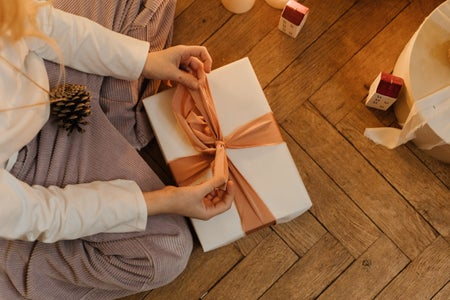 person wrapping gift