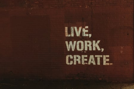 red brick wall with live, work, create