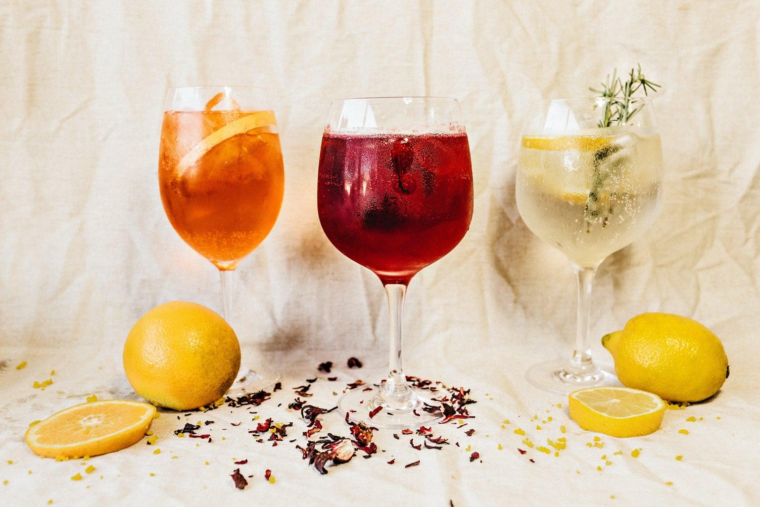 Three glasses of gin & tonic