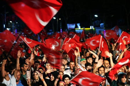 Group of Turkish people waving the Turkish flag