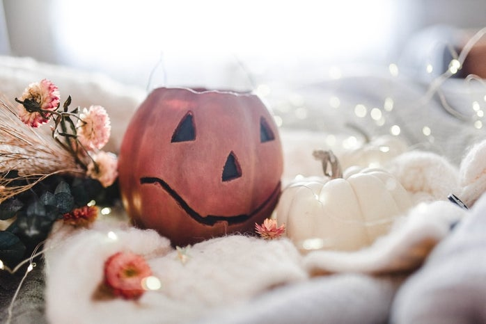Pumpkins, flowers, and lights on blankets