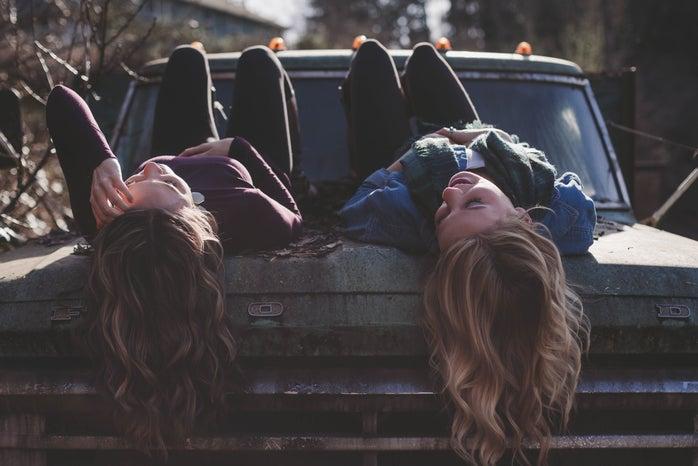 Girl best friends on truck