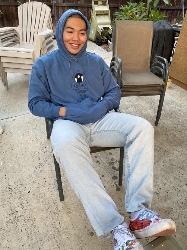 young man wearing blue sweatshirt