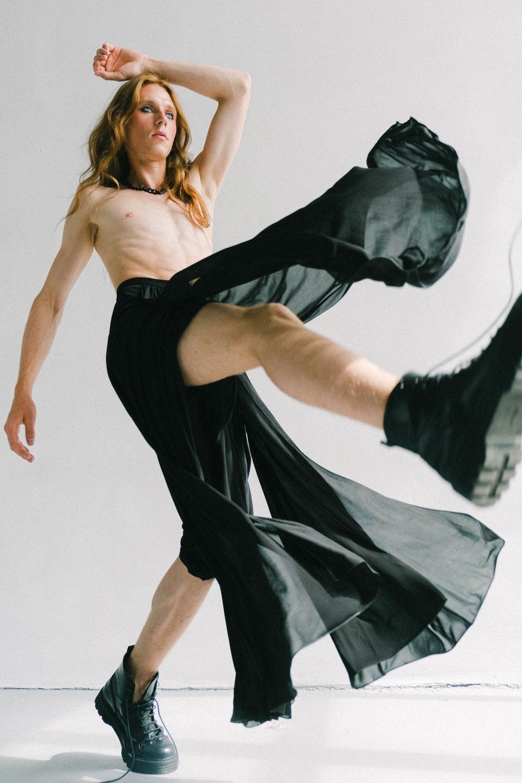 male fashion model posing in a skirt