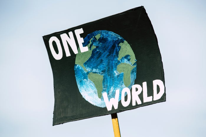 """sign that has the earth on it that says """"one world"""""""