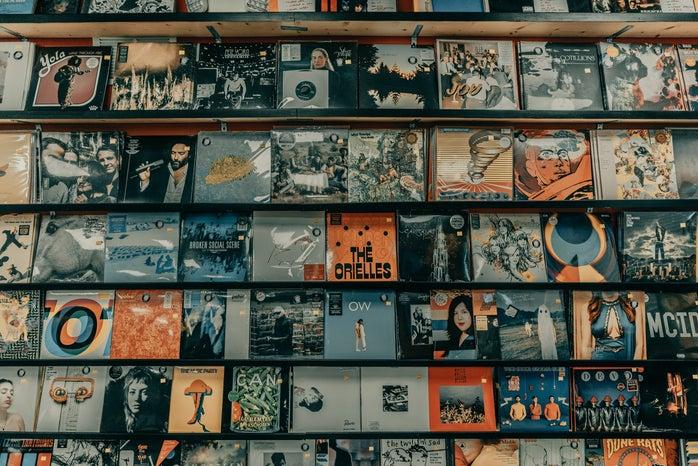 multiple albums on a shelf