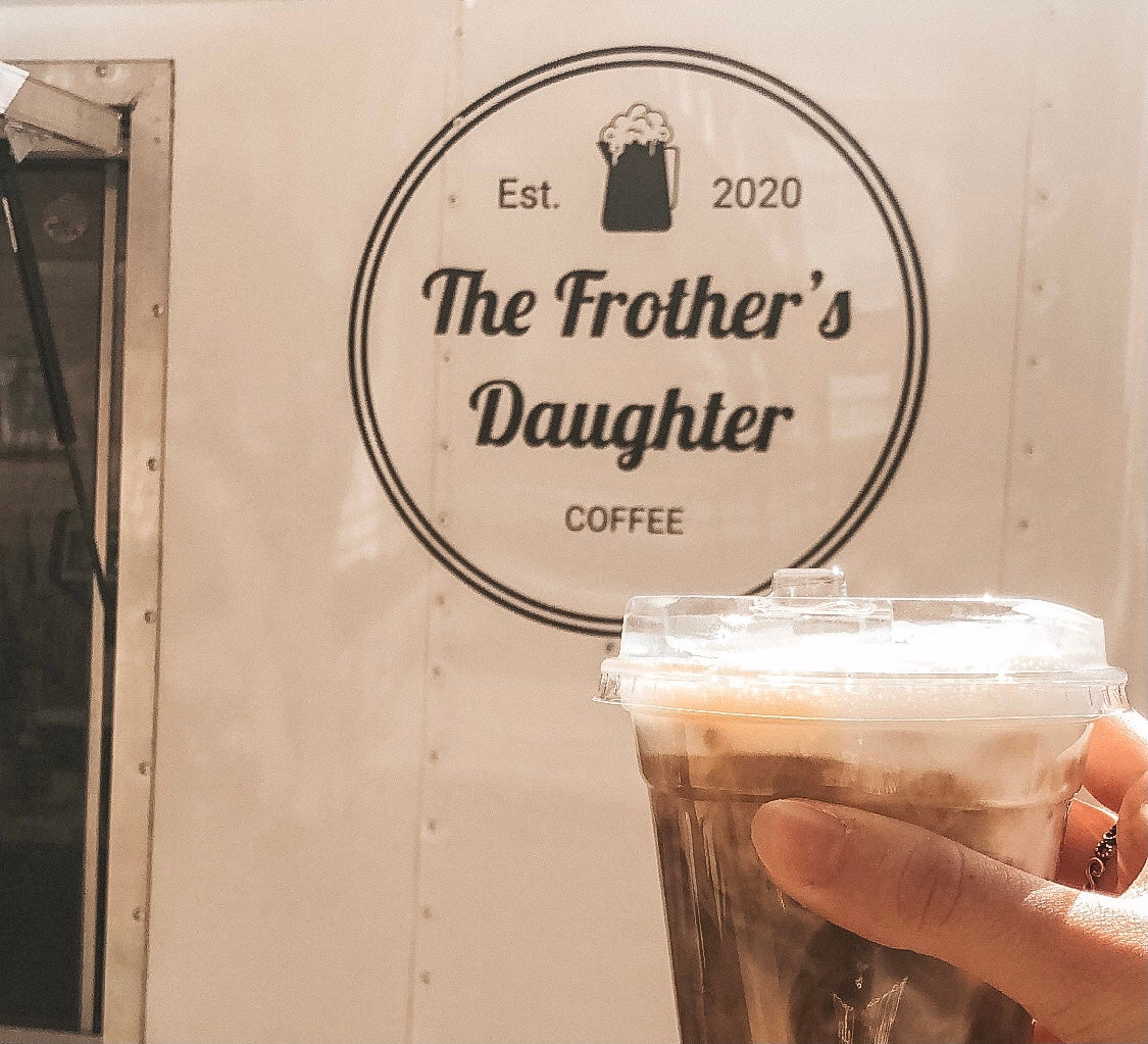 iced coffee in front of shop