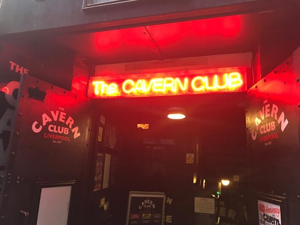 Photo of the doors and neon sign of The Cavern Club