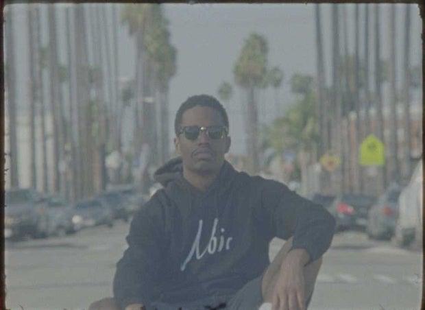young man wearing black sweatshirt