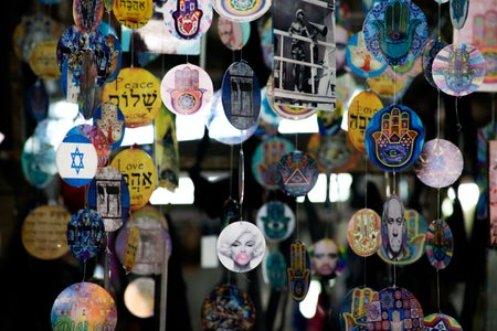 picture of decorations showing peace, the Hand of Hamsa, Netanyahu and other recognizable faces or phrases.