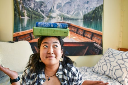 Woman with books balanced on her head