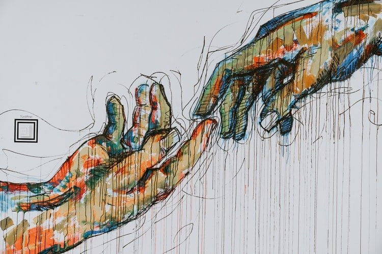 painting of hands touching