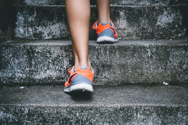 woman wearing sneakers on stairs