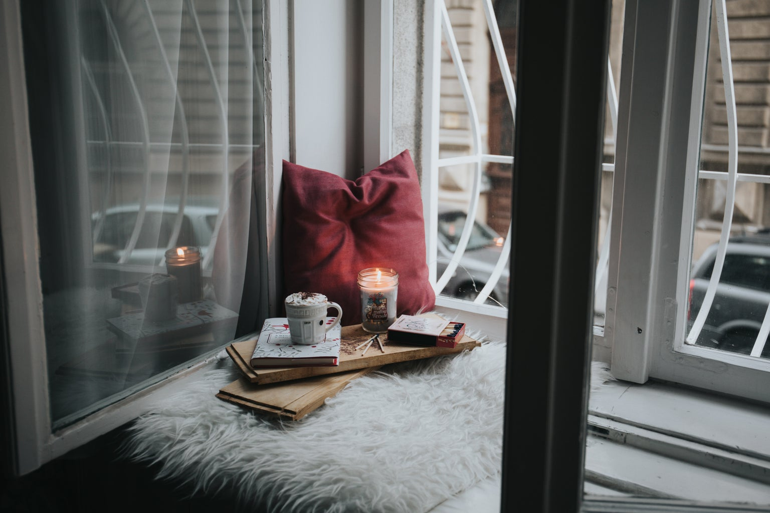 A room with books and a candle