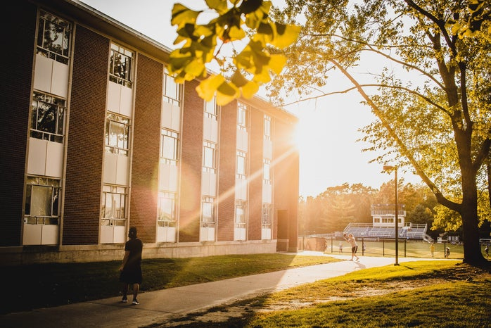 sun shining on a college campus