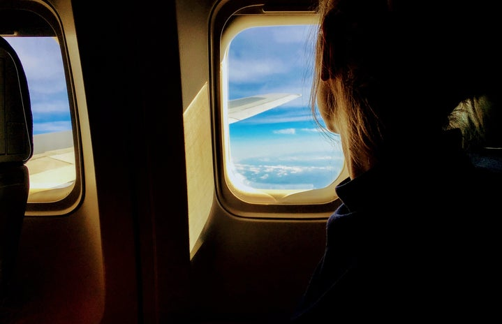 Person looking outside of an airplane