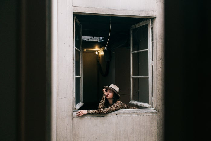 woman leaning out of a window