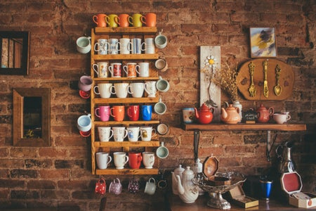 assorted mugs on wall zodiac decor