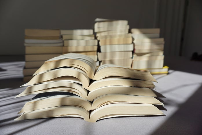 five stacked open books
