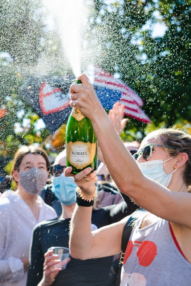 People holding champagne during day time