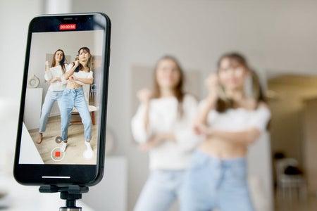 Two women recording a dancing video
