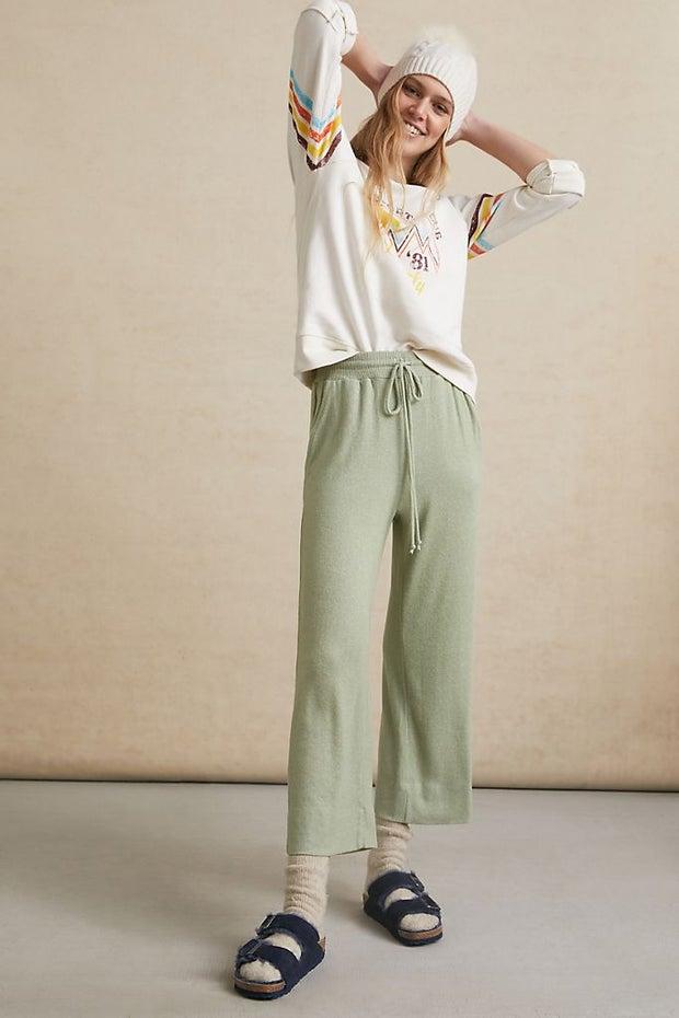 woman wearing wide-leg pants