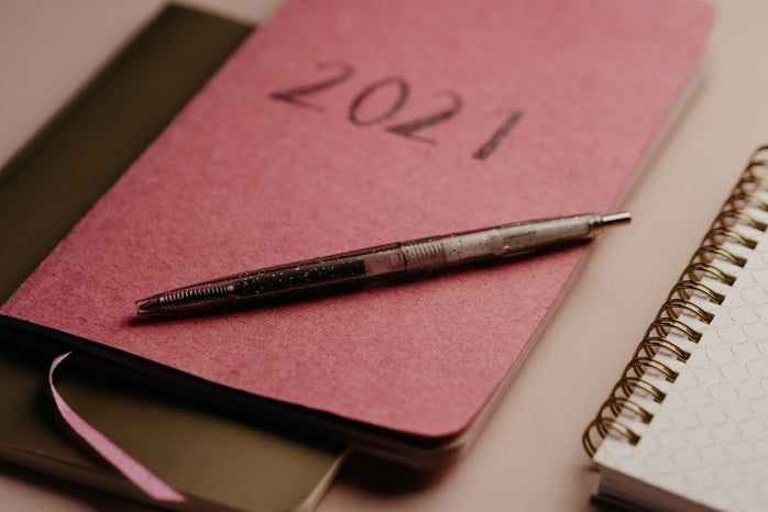 black pen on pink notebook
