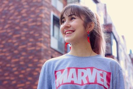woman wearing marvel shirt