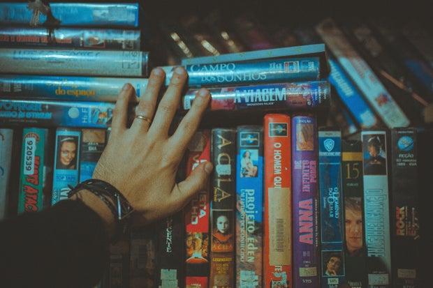 assorted movies on bookshelf