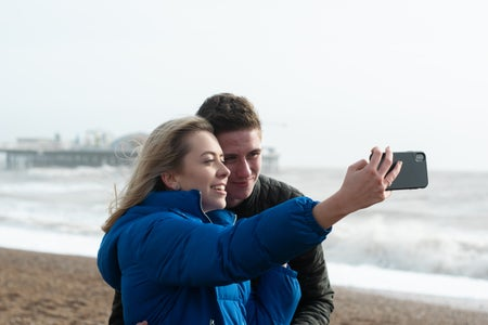 Couple on beach taking a selfie