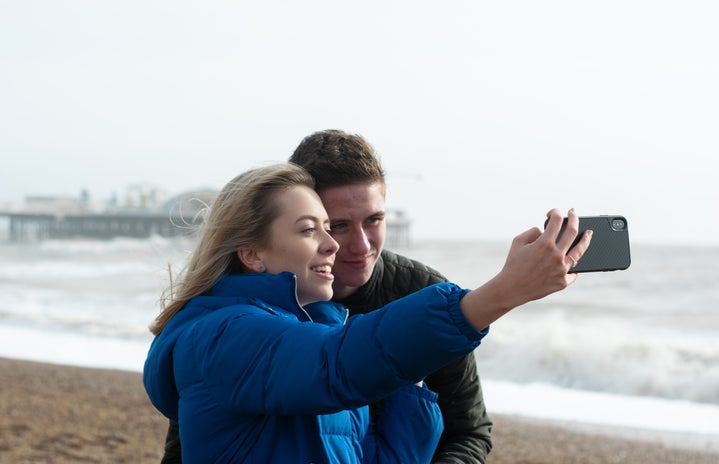 Couple on beach taking a selfie