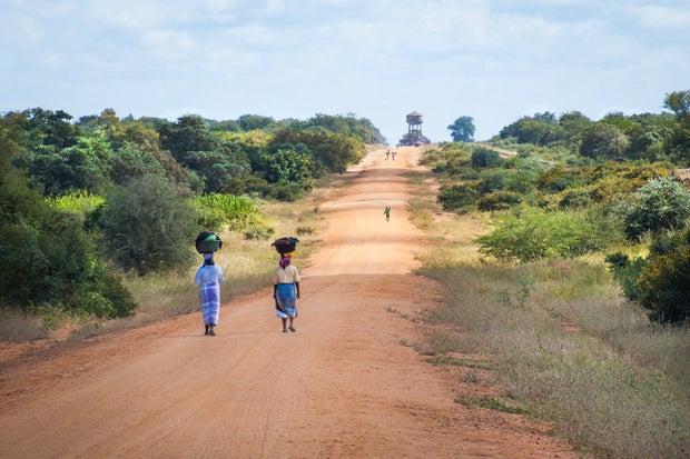 African women walking in road