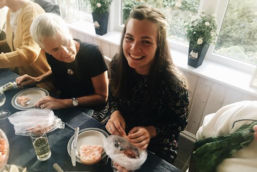 girl peeling shrimp in Norway