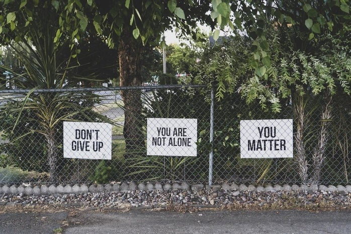 mental health signs on a fence