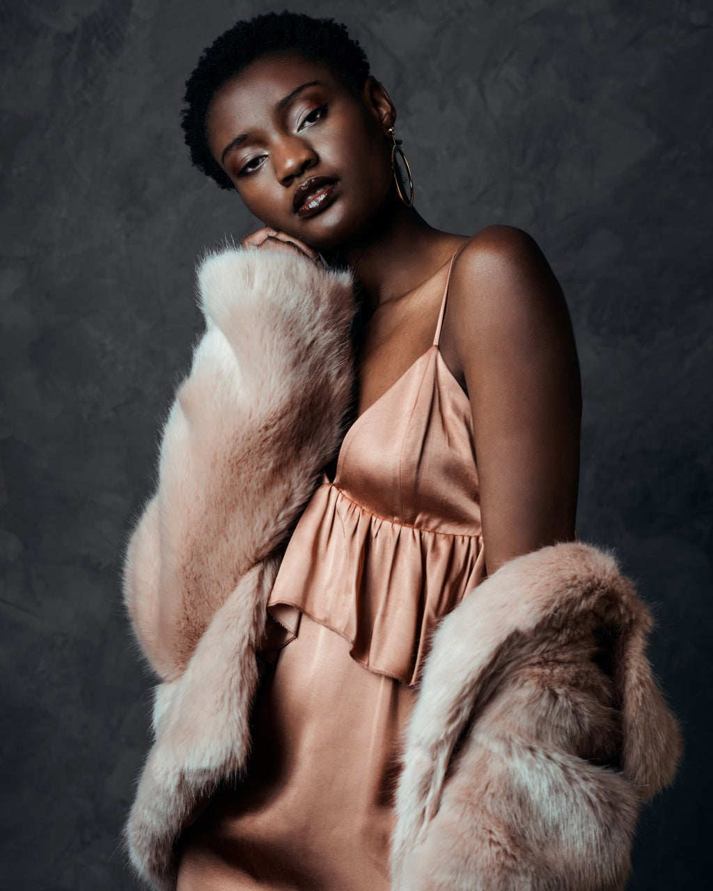 black model in a pink slip dress