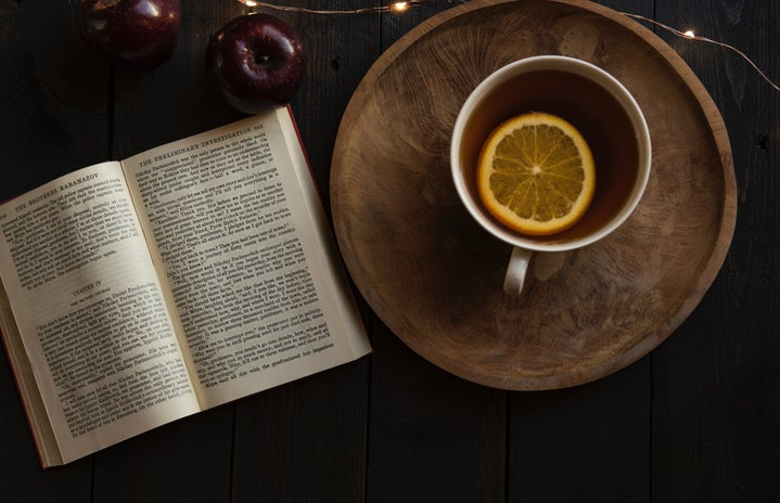 top view of open book with lemon in cup