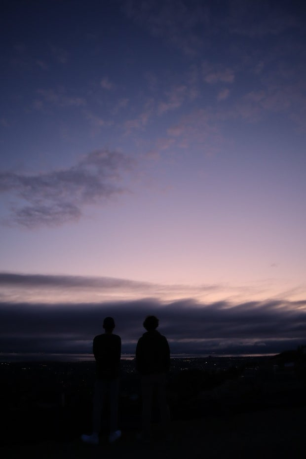 blue sky with two people looking at the sunset
