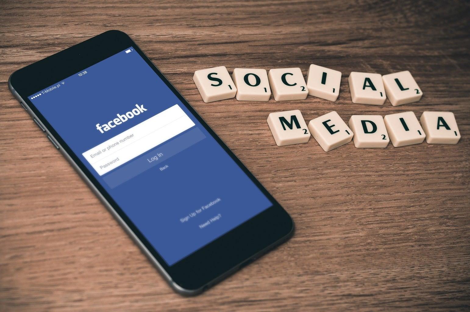 facebook login on phone with social media scrabble tiles