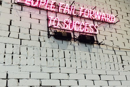 "neon sign ""people fail forward to success"""