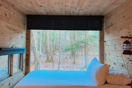 woods cabin bedroom getaway