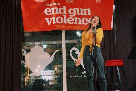 Juliana Simone Carrasco singing at we can end gun violence.