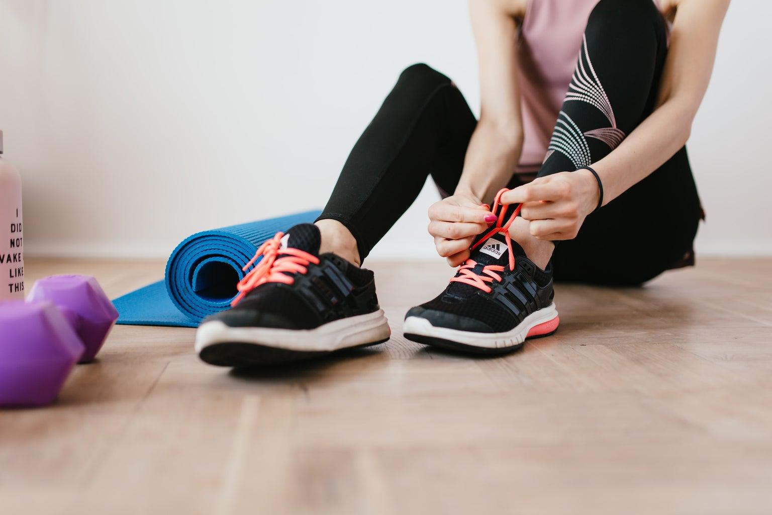woman tying running shoelaces