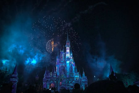 cinderella castle at night with fireworks
