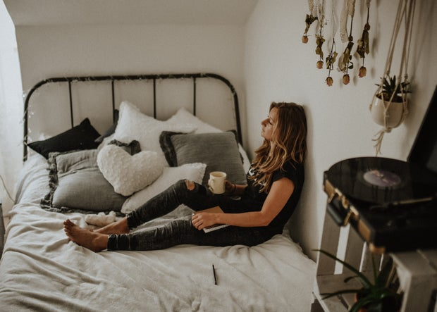 woman on bed with coffee