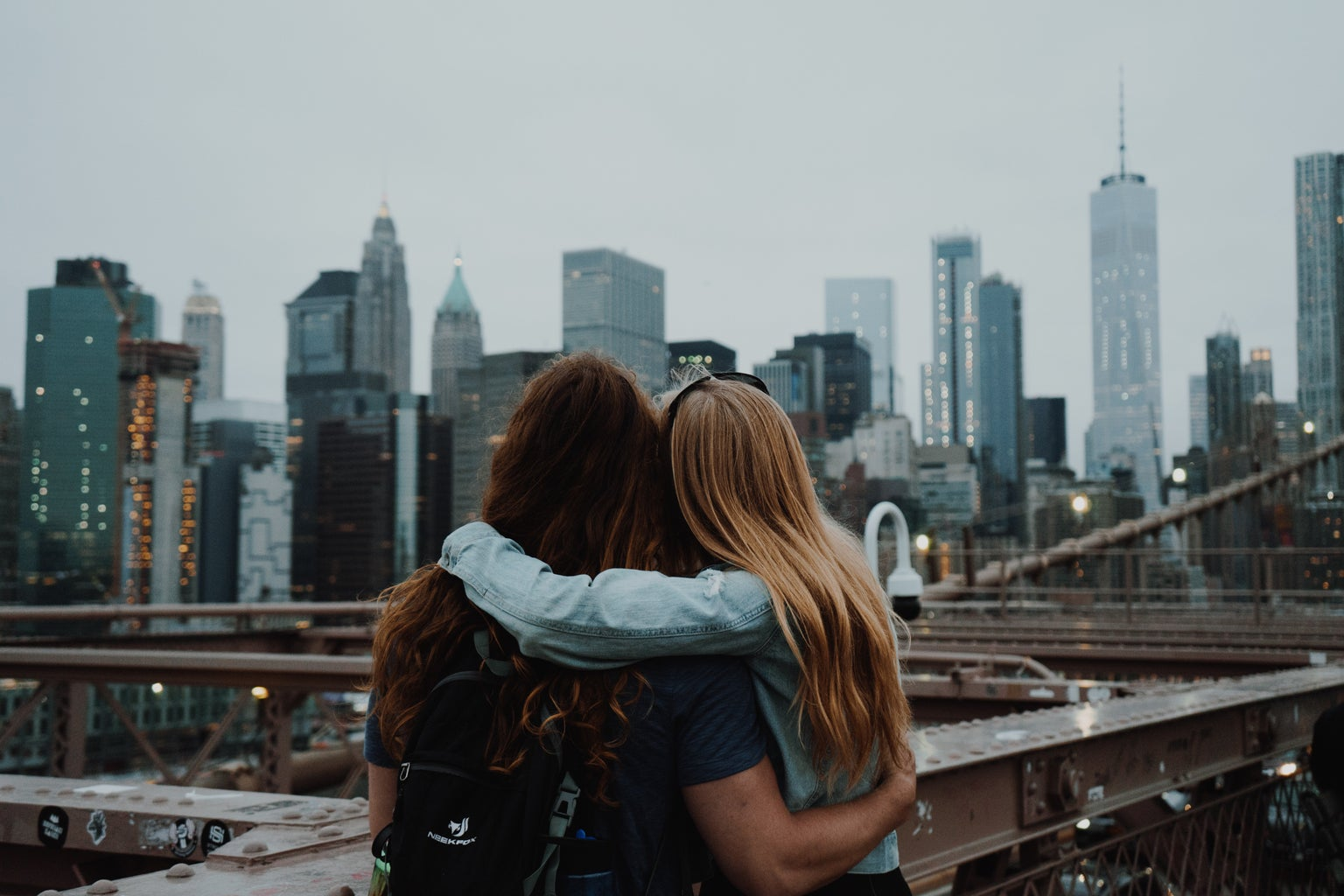 Two girls embracing from behind