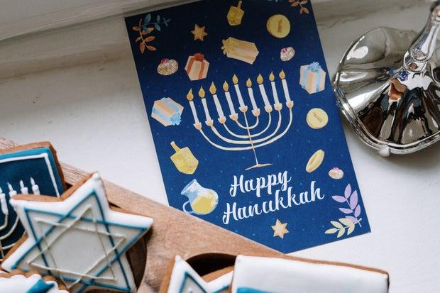 Hanukkah car near Menorah and holiday cookies
