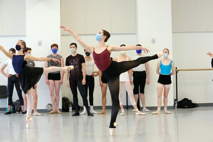 Lydia Morris and dancers in arabesque in ballet class