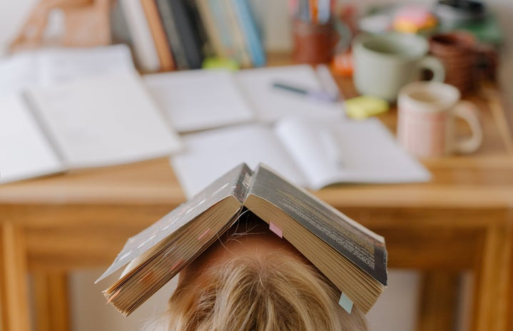 person with book on their head