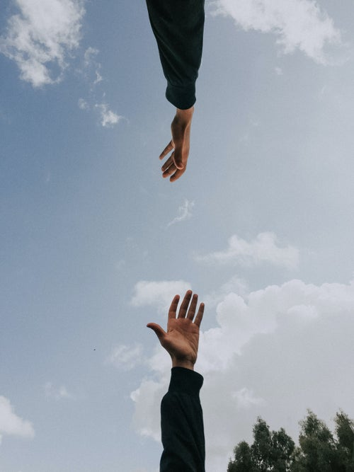 Hands reaching out